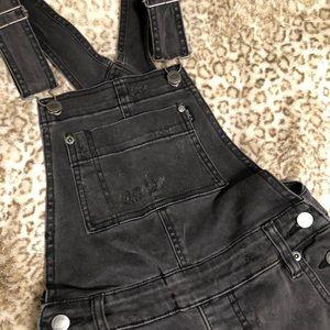 Black distressed overalls